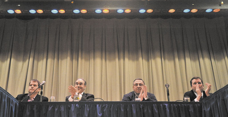 From left, David Bernhardt, Sec. of Transportation, Bruce Poliquin, State Treasurer, Gov. Paul LePage, and Stephen Bowen, education commissioner, listen to questions during a town hall meeting at Madison Junior High School Thursday night.