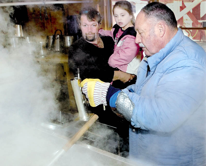 WELL-KNOWN: Clair Lewis tests a container of boiling maple syrup at his Parsons Valley Sugar Farm in Thorndike during a past Maine Maple Sunday event. Lewis died of injuries he sustained while cutting trees on Saturday near the sugar house.