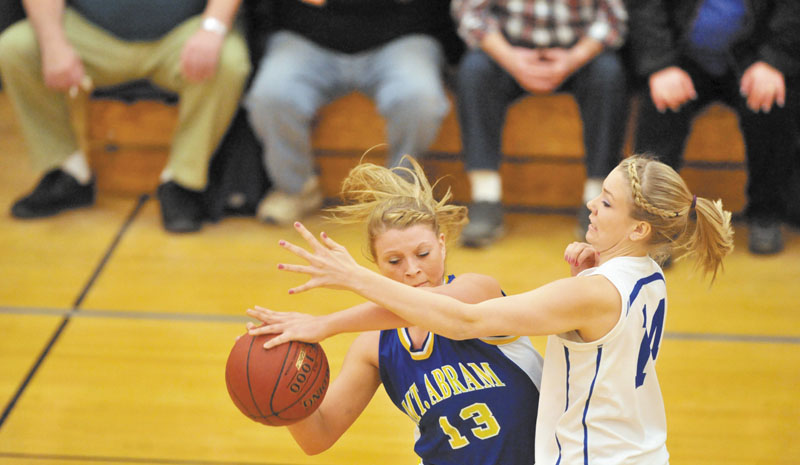 PRESSURE DEFENSE: Madison's Cristie Vicneire, right, defends Mt. Abram's Mikayla Luce in the second quarter Tuesday at Madison Area Memorial High School.