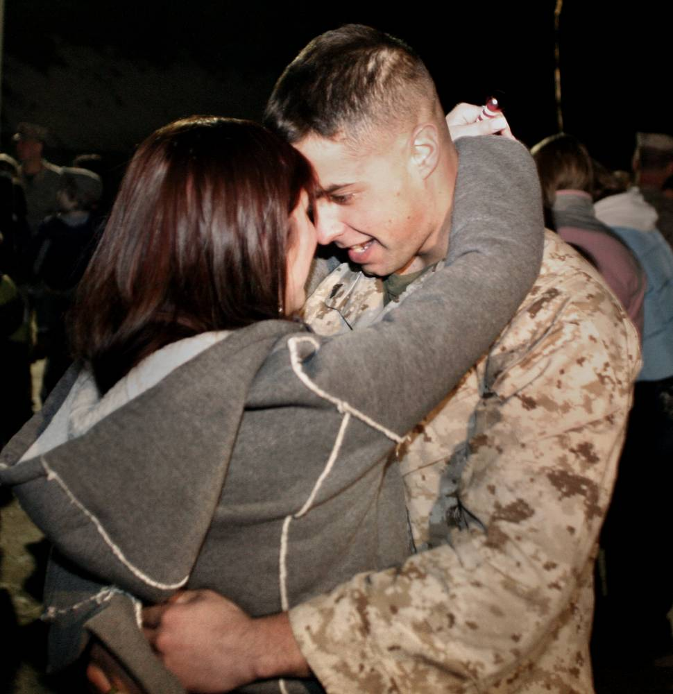 Brittany O'Malley embraces Cpt. David Bolcome Wednesday during the homecoming of Company A, 1st Battalion, 25th Marine Regiment, 4th Marine Division in Brunswick. The couple is from Rockport, Mass.