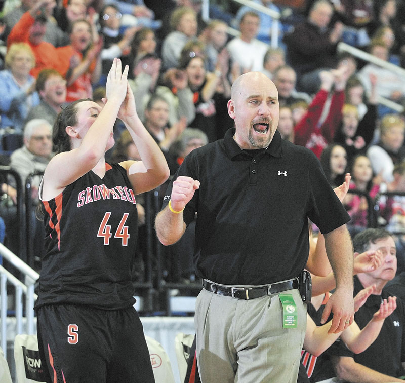 Skowhegan junior forward Andrea Quirion, left, and head coach Heath Cowan celebrate as the Tigers took a fourth quarter lead during the Class A East tournament on Friday night at the Augusta Civic Center. richmond buckfield standish softball