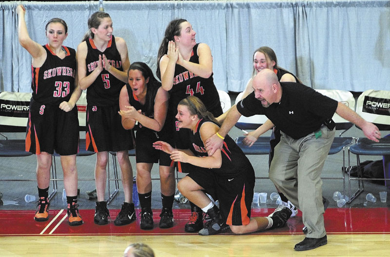 ALL RIGHT: Players on the Skowhegan bench and head coach Heath Cowan celebrate as the Indians beat Mt. Blue in on the first night of the Eastern Maine Class A tournament Friday at the Augusta Civic Center. richmond buckfield standish softball