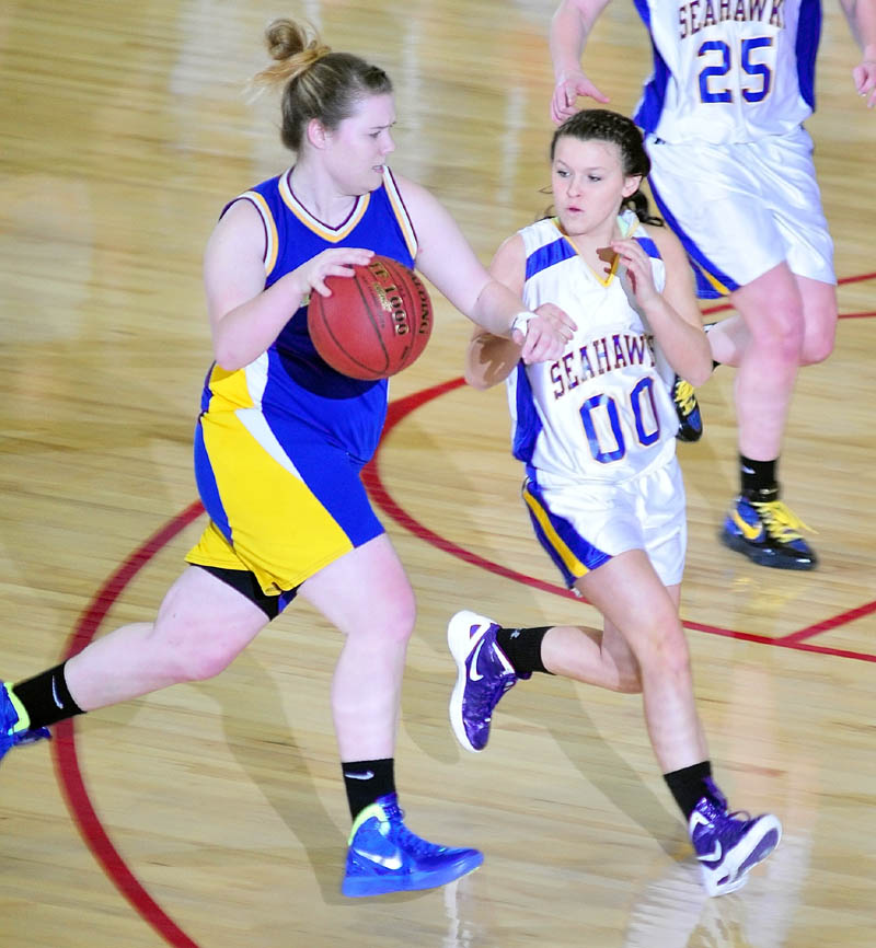 Mt. Abrams' Tori Beane tries to get past Boothbay Region's Abby McLellan during the Class D West tournament on Tuesday afternoon at the Augusta Civic Center.