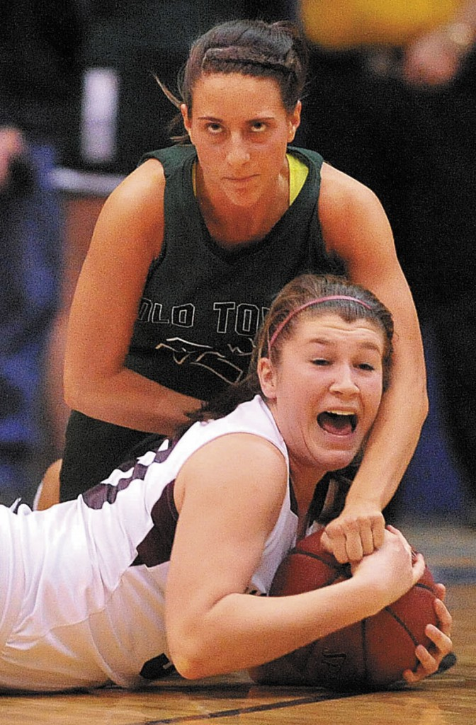 Nokomis High School's Anna Mackenzie, 30, bottom, battles for the loose ball with Old Town High School's Samantha McLaughlin, 22, top, in the second half of the Eastern Class B semi-finals at the Bangor Auditorium Wednesday.