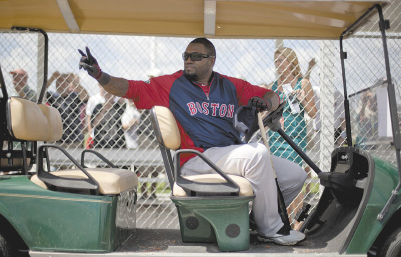 RIDING IN STYLE: Boston designated hitter David Ortiz takes a ride in a golf cart during spring training Tuesday in Fort Myers, Fla. Ortiz said it was an honor to be a teammate of catcher Jason Varitek, who will announce his retirement Thursday.