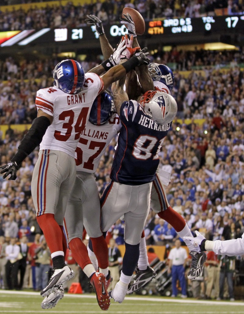 Patriots tight end Aaron Hernandez goes up against three Giants defenders in an unsuccessful attempt to catch Tom Brady's desperation heave into the end zone on the final play of the Super Bowl.