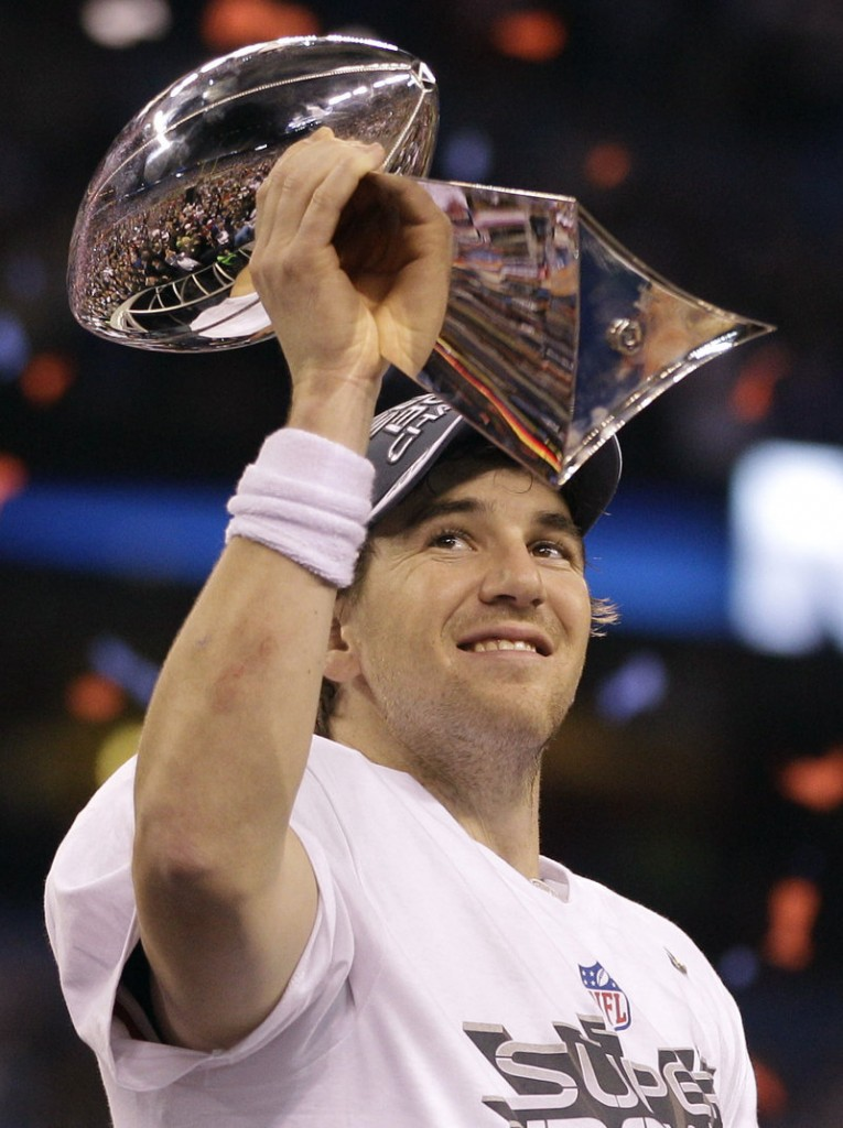 Giants quarterback Eli Manning holds up the Vince Lombardi Trophy given to the Super Bowl champions.