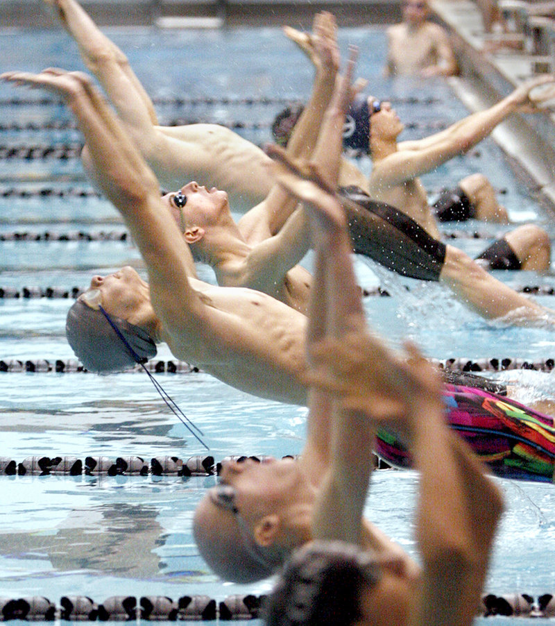 Jack Benoit of Greely launches into the water at the start of a 200-yard medley relay preliminary during the Class B state championships. Greely won the night race and the title.