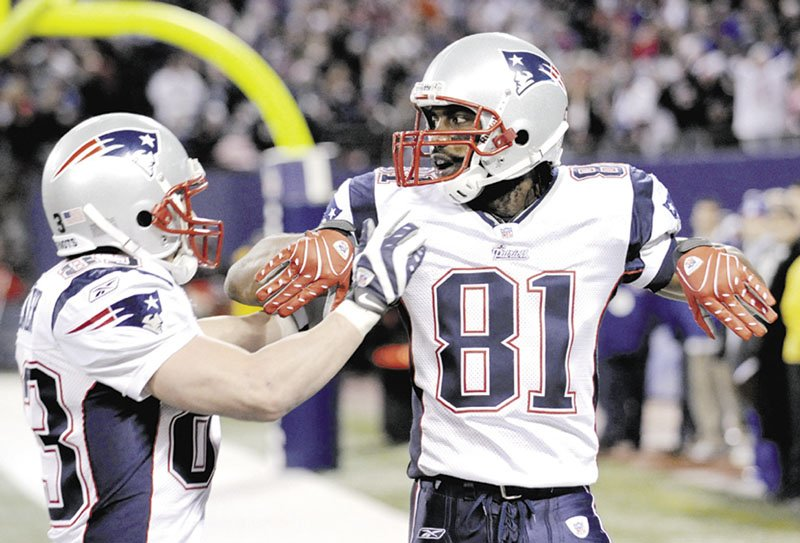 DOOR OPEN: Former New England Patriots wide receiver Randy Moss, right, annonced Monday on a webchat that he plans to return to the NFL. Moss retired six months ago.