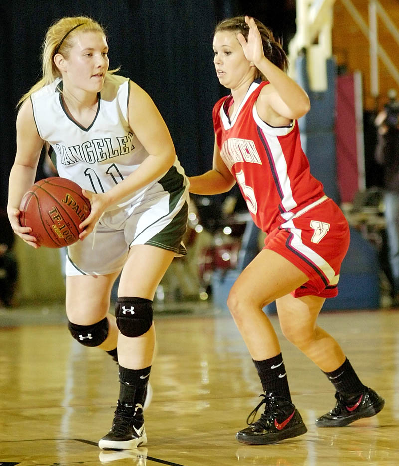 GOOD DEFENSE: Rangeley's Seve Deery-DeRaps is guarded by Vinalhaven's Eliza Davidson during the Western Maine Class D semifinals Thursday morning at the Augusta Civic Center.