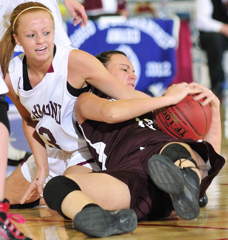 GIVE ME THAT: Richmond's Noell Acord, left, and Buckfield's Danielle Patrie wrestle for a loose ball during the Western Maine Class D quarterfinals Tuesday morning at the Augusta Civic Center.