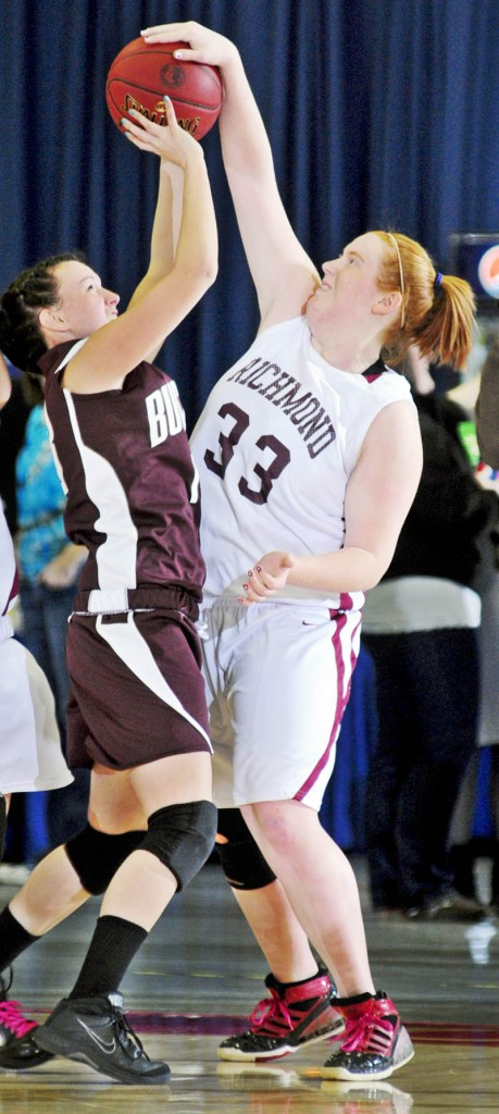 NOT HERE: Richmond's Alyssa Pearson, right, blocks a shot by Buckfield's Danielle Patrie during the Western Class D quarterfinals Tuesday morning at the Augusta Civic Center.