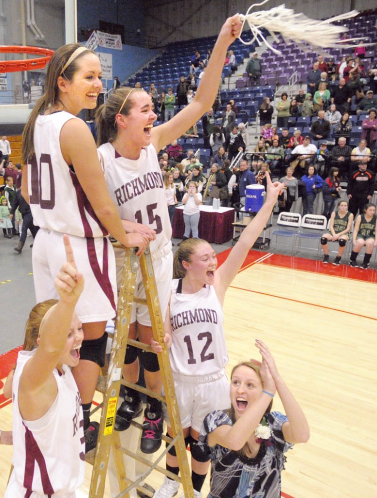 SWING THE NET: Richmond's Alyssa Pearson, left, Danica Hurley, Jamie Plummer and Brianna Snedeker and manager Kayla Hurley celebrate after beating Rangeley to win the Western Maine Class D championship Saturday afternoon at the Augusta Civic Center.