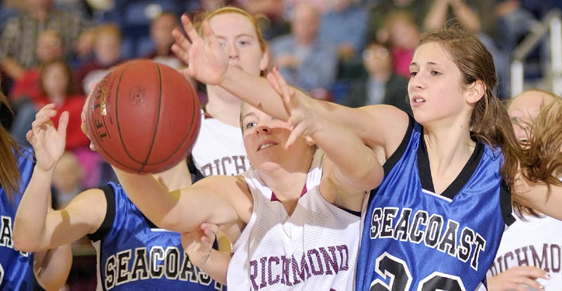 GET BACK HERE: Richmond's Lindsy Hoopingarner, left, and Seacoast Christian's Kylene DeSmith battle for a rebound during the Western Maine Class D semifinals Thursday morning at the Augusta Civic Center.