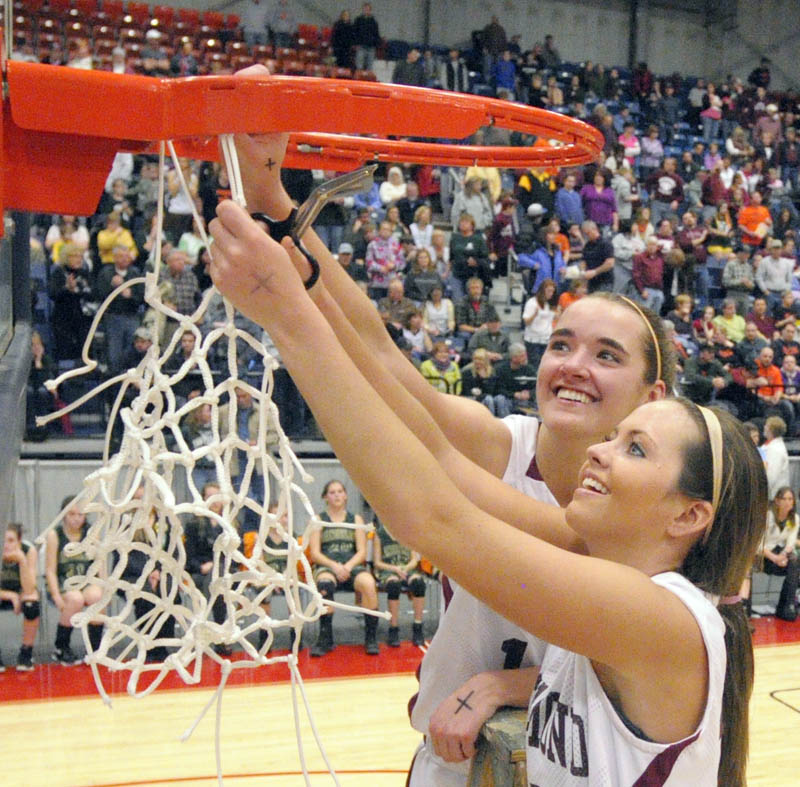 Staff photo by Joe Phelan Richmond captains Jamie Plummer, top, and Danica Hurley cut down the net after the Bobcats won the Western Maine Class D championship on Saturday afternoon at the Augusta Civic Center.