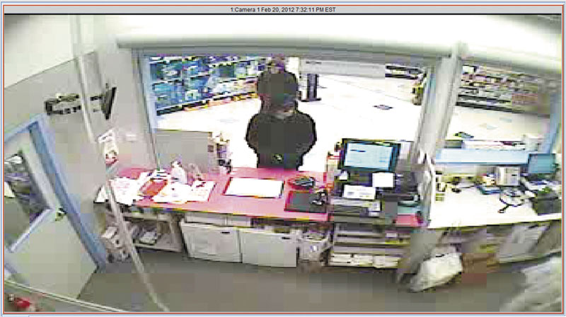 Two men are seen robbing a Rite Aid at 2007 North Belfast Ave. in Augusta Monday night. It was the second robbery at a city pharmacy in less than week.