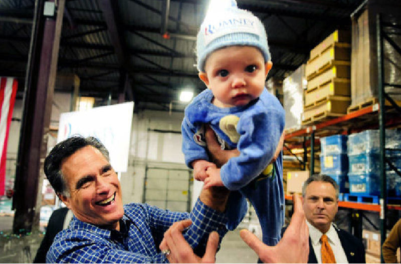Republican presidential candidate Mitt Romney plays with 6-month-old Dexter Hall of Plymouth, Minn., on Wednesday.