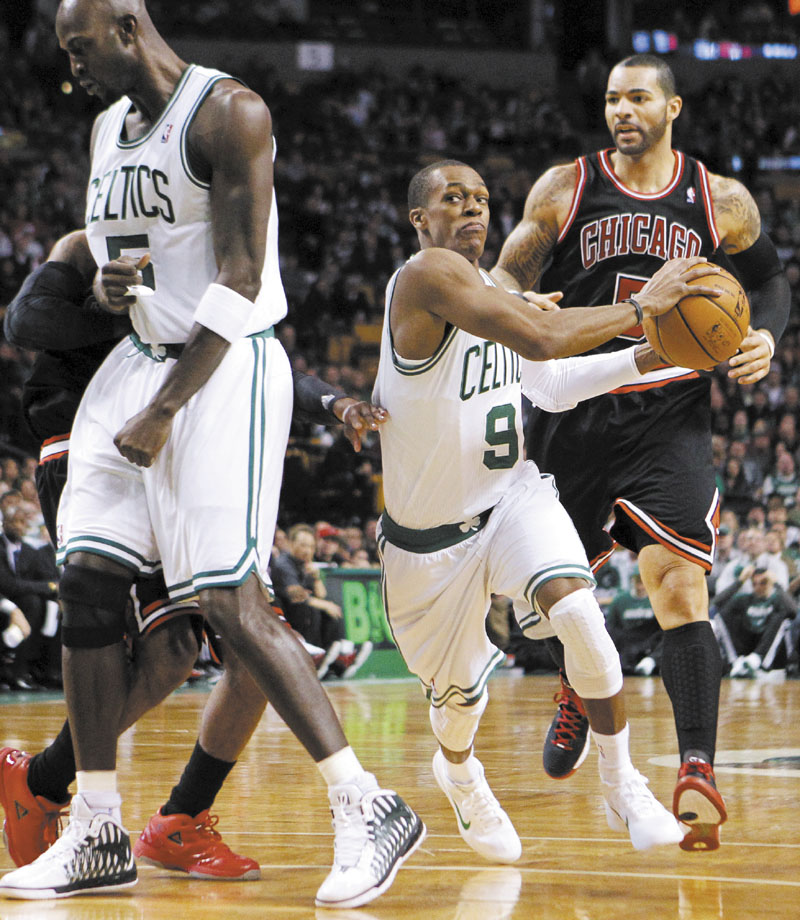 ON FIRE: Rajon Rondo (9) had a triple-double, finishing with 32 points, 15 assists and 10 rebounds in the Celtics' 95-91 win over Chicago on Sunday in Boston.