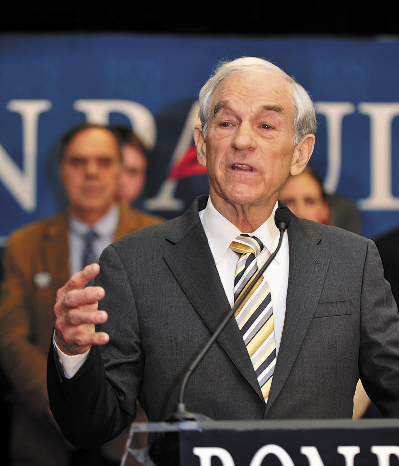 RUNNER-UP: U.S. Rep. Ron Paul, R-Texas, talks to supporters Saturday at the Seasons Event and Conference Center in Portland. Paul finished behind Mitt Romney.