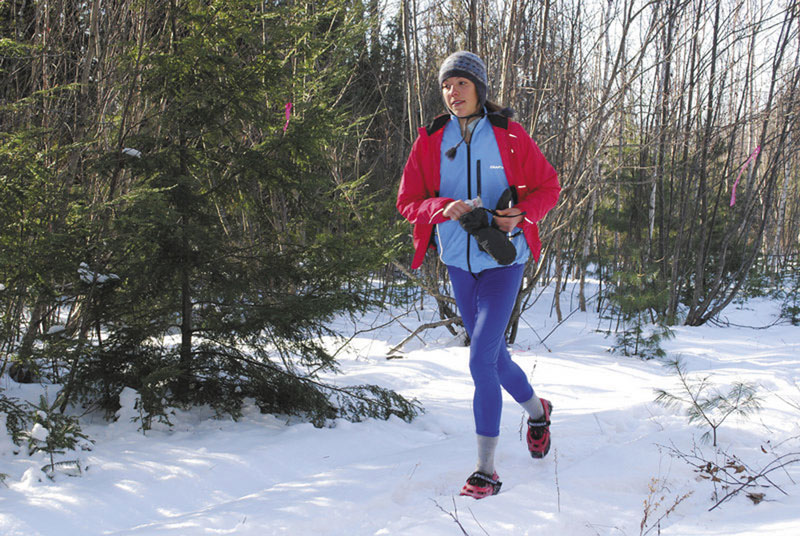 Stay warm: Desiree Sirois of Bar Harbor keeps an 8-minute, 24-second pace up on the 4.9-mile course of the State of Maine Championship last month in Orland. Of course, Sirois was running in trail shoes this year, not snowshoes.
