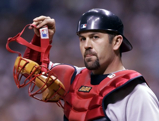 An April 2006 photo of Red Sox catcher Jason Varitek looking into the dugout during the first inning of a game against Tampa Bay in St. Petersburg, Fla. Now that the news is out Varitek has decided to retire after 15 seasons as the catcher in Boston, it doesn't make it any easier to take.