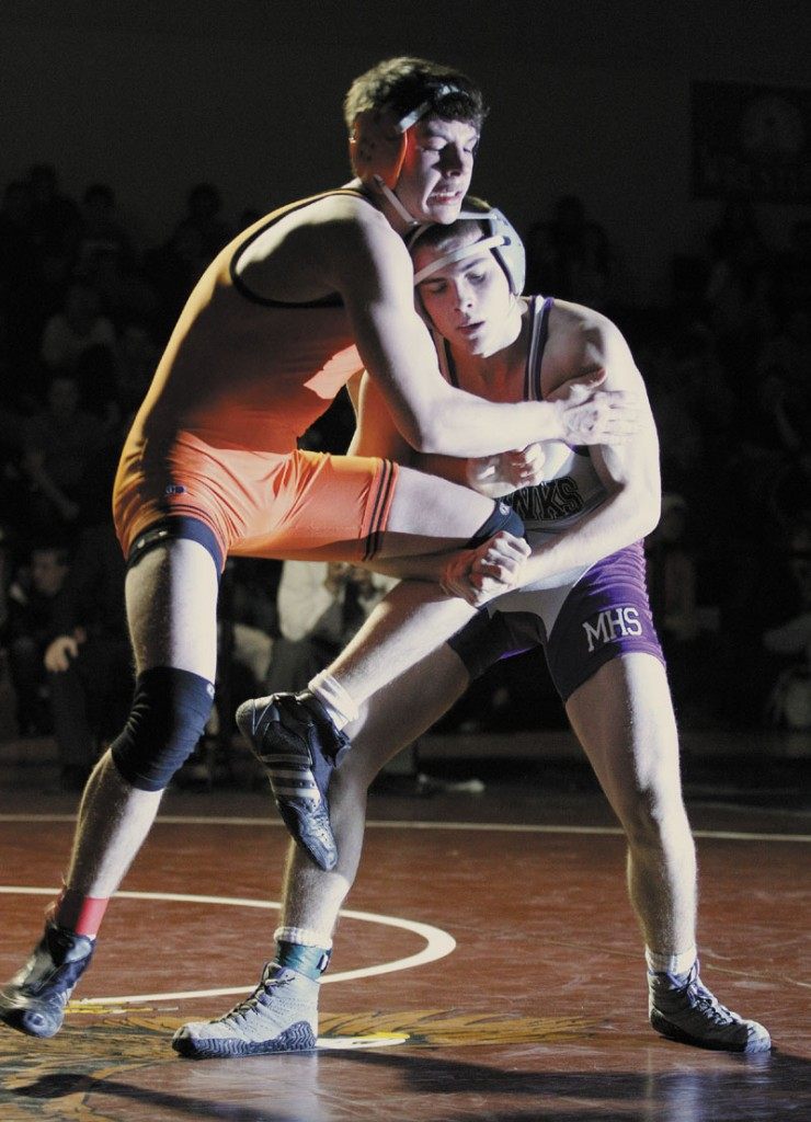 Nicholas Janes of Marshwood, right, tries to take down Skowhegan's Carter Stevens in the 145 pound class during the Class A State Championships.