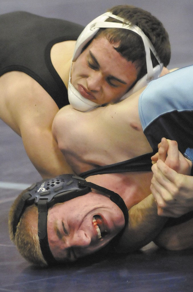 NO ESCAPE: Westbrook's Cal Randall, bottom, struggles to get out of the grasp of Skowhegan's Kaleb Brown in a 138-pound match on Saturday in Westbrook. Brown won the weight class and helped Skowhegan to a third-place finish in the Eastern A regional meet.