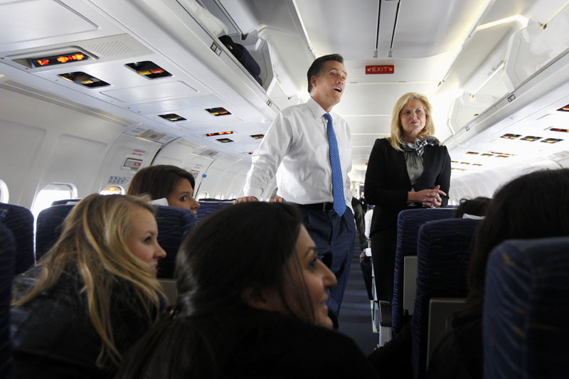 AIR ROMNEY: Republican presidential candidate Mitt Romney and his wife Ann talk to reporters Tuesday on his campaign plane in Columbus, Ohio, before taking off for Boston.