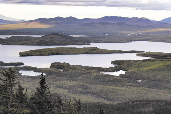 BIG LAKE: This May 2004 file photo shows Moosehead Lake and the surrounding woods near Greenville. The supreme court ruled Thursday that the Land Use Regulation Commission didn't violate any procedural rules in approving a massive residential development in the Moosehead Lake region. The ruling gives the green light to the project that covers thousands of acres in one of the state's unspoiled regions.
