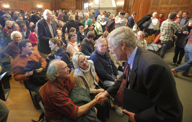 Angus King greets supporters at Bowdoin College on Monday night after announcing that he will run for the Senate seat being vacated by Olympia Snowe.