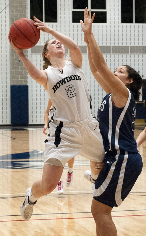 Kaitlin Donahoe goes up for a basket during Bowdoin's NCAA tournament game Friday night against George Fox. Donahoe scored 18 points, but the Polar Bears lost, 71-55.