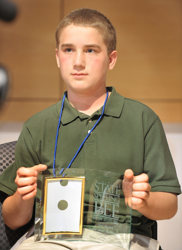 Nat Jordan holds the trophy he won in the annual Maine State Spelling Bee on Saturday.