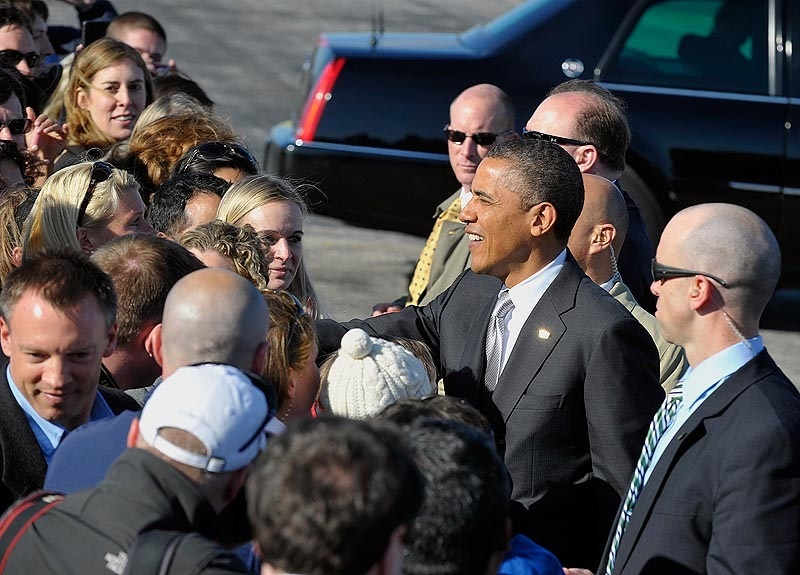 President Obama arrives on Air Force One at Portland Jetport on Friday and shakes hands with VIPs and their families.