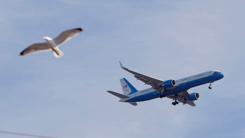 Air Force One flies over Southern Maine Community College, before he lands at the Portland International Jetport.