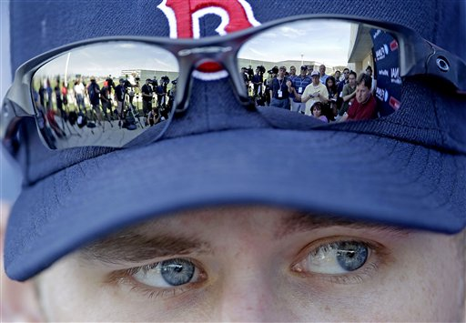 Members of the media are reflected in the sunglasses of Boston Red Sox pitcher Daniel Bard in this Feb. 21, 2012, photo.
