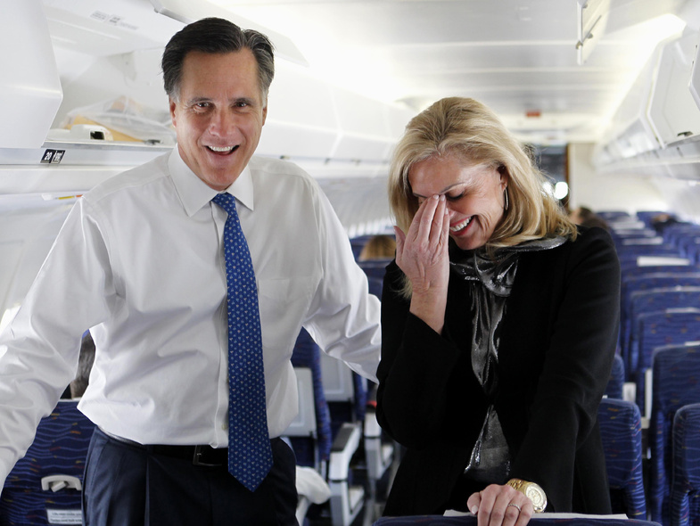 Republican presidential candidate, former Massachusetts Gov. Mitt Romney, and his wife Ann, talk to reporters on his campaign plane before taking off for Boston, in Columbus, Ohio, on Tuesday.