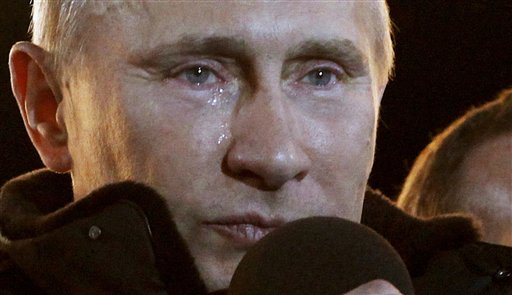 """Flanked by President Dmitry Medvedev, a teary Vladimir Putin tells a massive rally of his supporters Sunday outside the Kremlin, """"I promised that we would win and we have won!"""""""