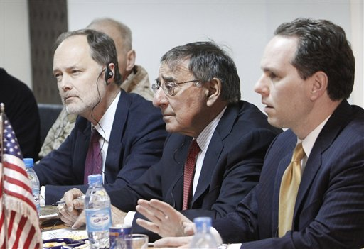 U.S. Secretary of Defense Leon Panetta, center, listens to his Afghan counterpart Bismillah Mohammadi, unseen, during a meeting at the interior ministry in Kabul today.