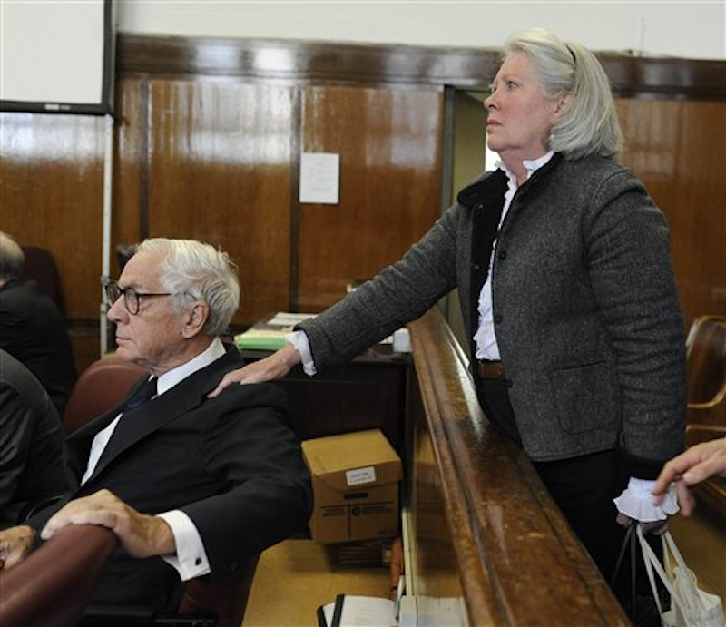 In this Oct. 8, 2009 photo, Charlene Marshall holds the shoulder of her husband, Anthony Marshall, in a courtroom in New York. Brooke Astor's 85-year-old son Marshall was convicted Thursday of exploiting his philanthropist mother's failing mind and helping himself to her nearly $200 million fortune. Elder financial abuse encompasses a wide range of tactics, some perpetrated by relatives or trusted advisers, some by strangers via telemarketing and Internet-based scams. A federal study found that 5 percent of Americans 60 and older had been the victim of recent financial exploitation by a family member, and 6.5 percent by a non-family member. (AP Photo/Steven Hirsch)