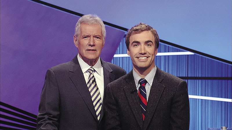 """Ben Parks-Stamm, of Winthrop, right, is seen with Alex Trebek, the host of the """"Jeopardy!"""" quiz show. Parks-Stamm, an apple farmer who graduated from Princeton University, competes in a show that airs tonight at 7:30 p.m. on WMTW-TV Channel 8."""