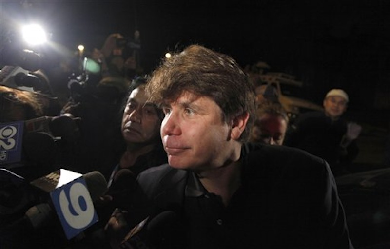 Former Illinois Gov. Rod Blagojevich departs his Chicago home for Littleton, Colo., to begin his 14-year prison sentence on corruption charges Thursday, March 15, 2012. (AP Photo/Charles Rex Arbogast)