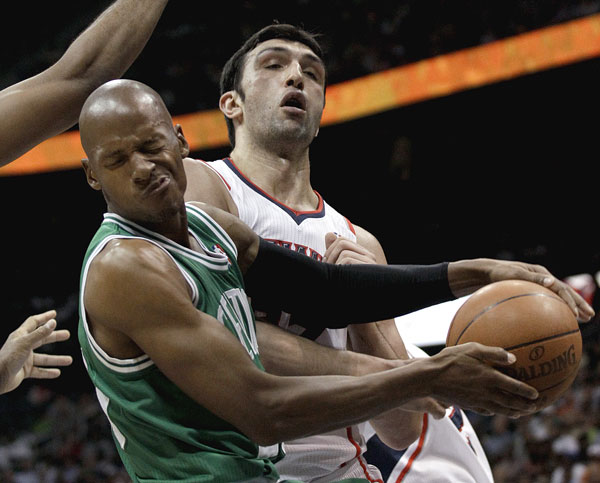 CLUTCH PLAY: Ray Allen hit two 3-pointers in Boston's 13-0 run in the fourth quarter and protected the lead with two free throws in the final seconds as the Boston Celtics held on to beat the Atlanta Hawks 79-76 on Monday night in Atlanta.