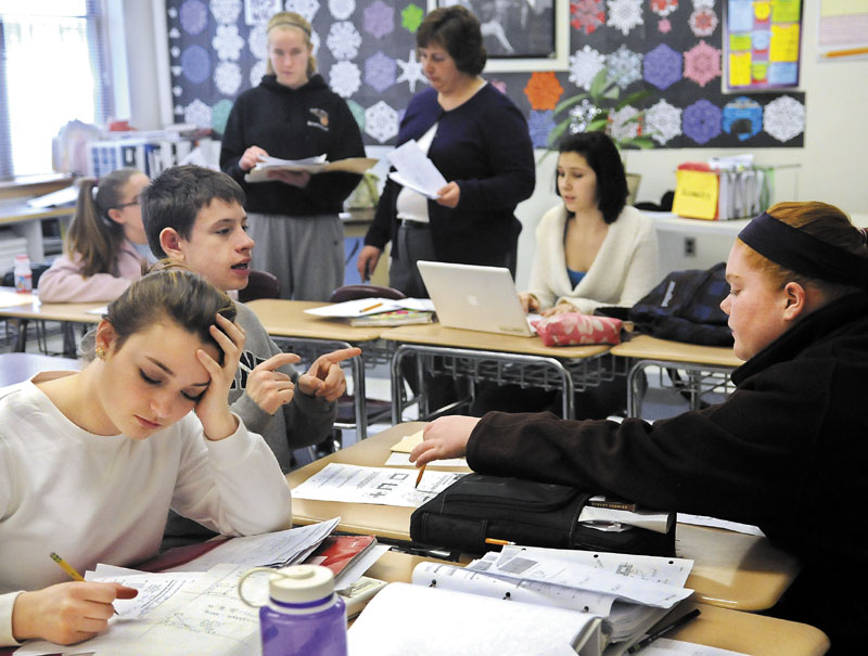 2014 FILE PHOTO: Hall-Dale High School students work on a geometry lesson in Kendra Guiou's classroom in Farmingdale. The entire school district has adopted proficiency-based education, a new education model that all Maine public schools may need to enact in the next decade.