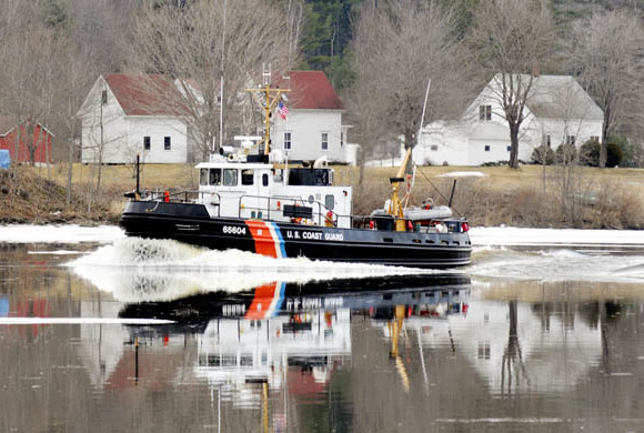 In this 2012 file photo, a Coast Guard ice cutter cruises up the Kennebec River past the Moulton Farm in Pittston.