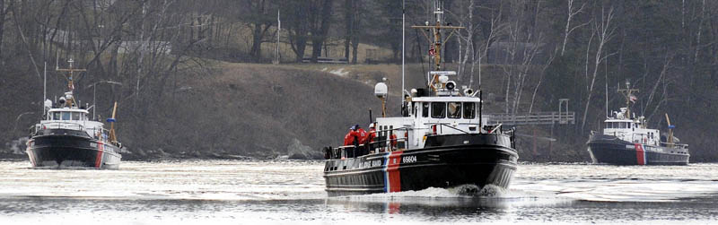Three Coast Guard ice cutters cruise Tuesday up the Kennebec River between Randolph and Gardiner.