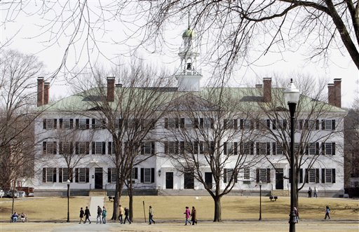 Students walk across the Dartmouth College campus in Hanover, N.H., on Monday. More than a quarter of the Sigma Alpha Epsilon fraternity's membership has been accused by the school's judicial council of hazing after a former member's public airing of what he says he experienced as a pledge in 2009.