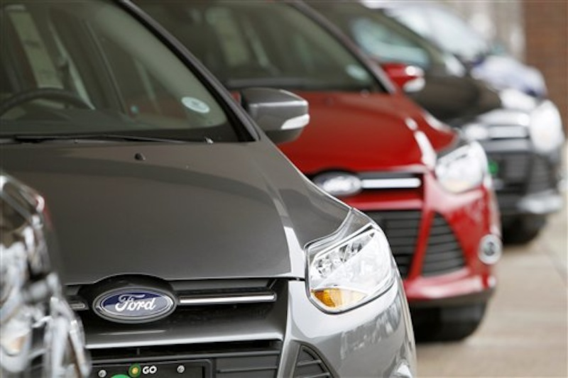 This Feb. 19, 2012 photo shows a line of 2012 Focus sedans at a Ford dealership in the south Denver suburb of Littleton, Colo. Ford Motor Co. said Thursday, March 1, 2012, its U.S. sales rose 14 percent in February thanks to big demand for its Focus compact car. (AP Photo/David Zalubowski)