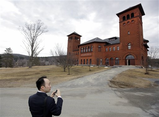 Christopher Chou, chief of staff at the World Evangelical Alliance, shoots a picture of the auditorium on an historic 217-acre campus in Northfield, Mass., last week. The campus, along with its 43 buildings, is being offered for free to an orthodox Christian group who can come up a solid plan to use it.