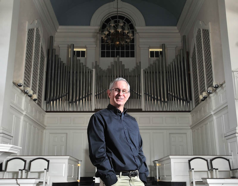 Colby College Symphony Orchestra Director Jonathan Hallstrom, who plans to resign after 28 years and 100 concerts, poses for a portrait at Lorimer Chapel at Colby College in Waterville onWednesday.