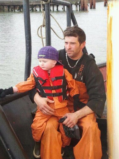 This 2011 photo provided by Adam Bjaranson shows Jason Bjaranson with his son. Jason Bjaranson practiced the life-or-death task of getting into his survival suit so he could do it in 13 seconds, but that didn't make a difference when the Lady Cecelia went down sometime on Saturday.